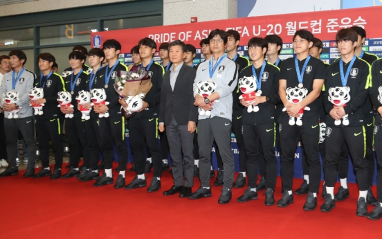 S. Korean players receive heroes' welcome
