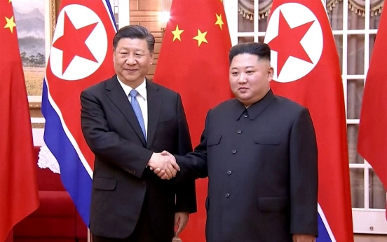 In summit with Kim, Xi vows active role in NK security, Korean Peninsula issues
