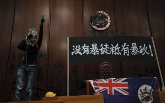 Riot police clear away protests from Hong Kong legislature