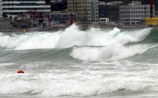 One found dead as typhoon alert lifted