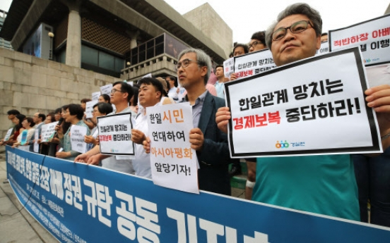 Civic groups condemn Japan for trade feud