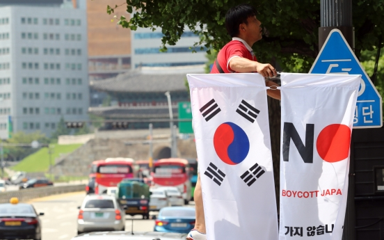 'No Japan' flags in Seoul streets taken down in face of public outrage