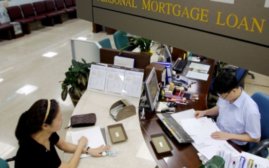 [News Focus] Real estate mortgages hinder economic growth