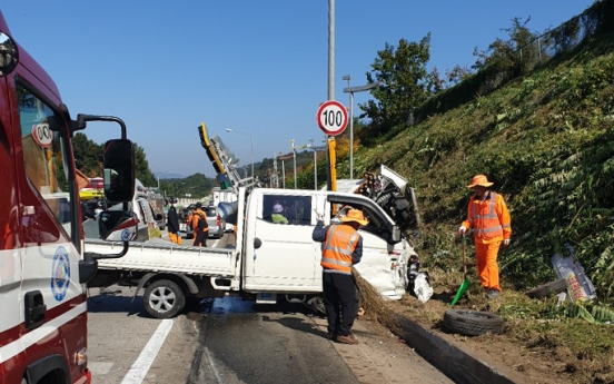 Three workers cutting grass killed after expressway truck collision