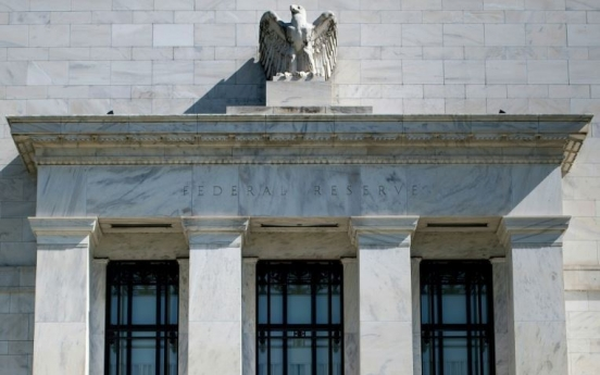 US Fed lowers key interest rate as 'insurance' against economic risks