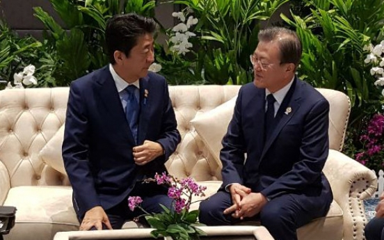 Moon, Abe agree to seek resolution to trade issues