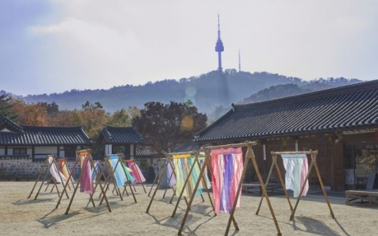 Namsangol Hanok Village incorporates modern artifacts inspired by Korean traditional themes
