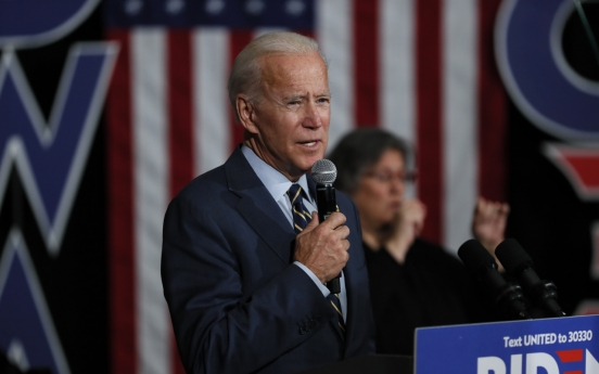 Biden says NK insults 'badge of honor'