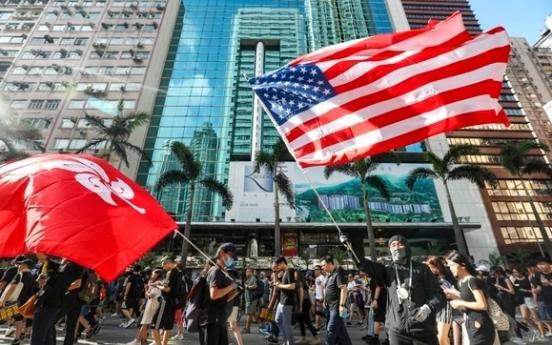 Trump signs law supporting Hong Kong protesters