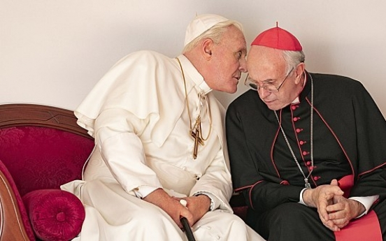 [Herald Review] Two's company: Hopkins and Pryce enliven papal buddy film 'The Two Popes'