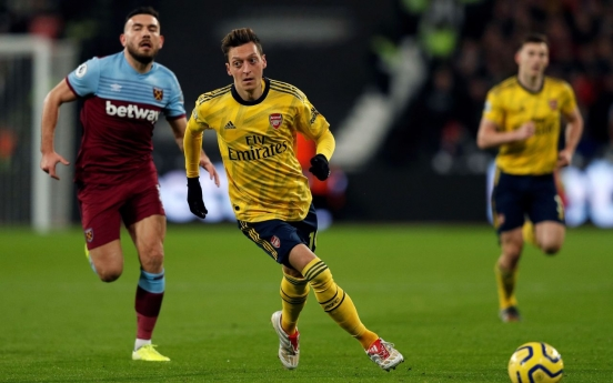 China says Arsenal's Ozil 'deceived by fake news'