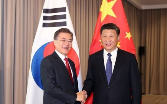 Moon to hold summit with Xi next week amid stalled NK nuke talks