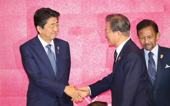 Moon, Abe to hold summit on disputes over trade, shared history