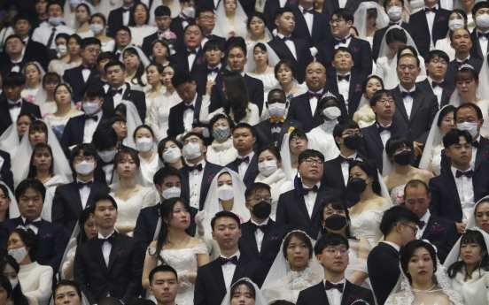 In sickness and in health: mass wedding defies virus fears