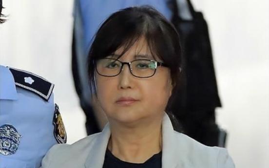 Court reduces jail sentence of former president's confidante in retrial