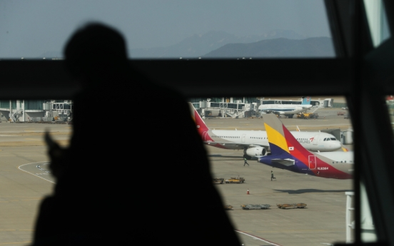 [Newsmaker] Asiana flight turns back en route to Vietnam on coronavirus