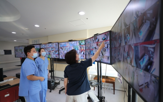 S. Korea's virus cases near 7,500, but pace of new infections slows