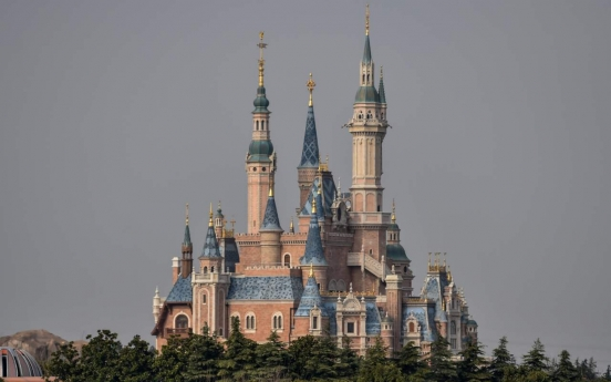Disney closes US and Paris theme parks, delays 'Mulan' over virus