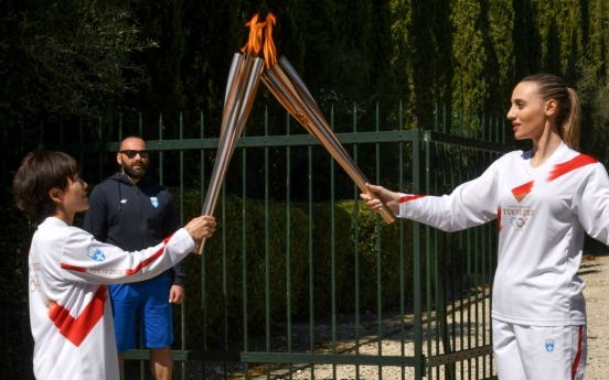Greek organisers scrap Olympic torch relay because of crowds