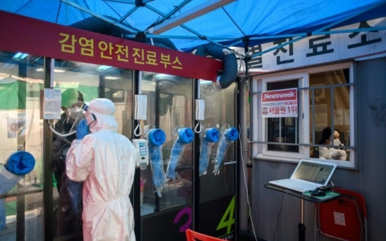 S. Korea dials up virus testing with hospital 'phone booths'