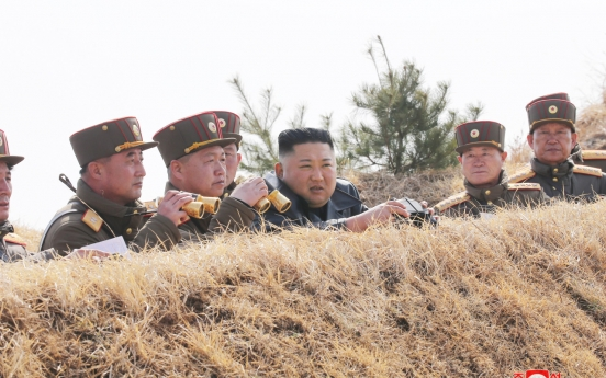NK party officials congratulate artillery unit in rare visit