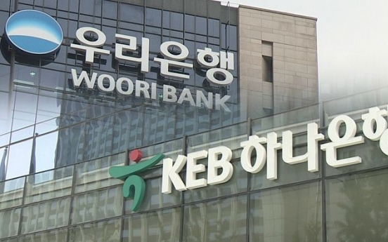 Financial watchdog warns Woori, Hana over board infractions