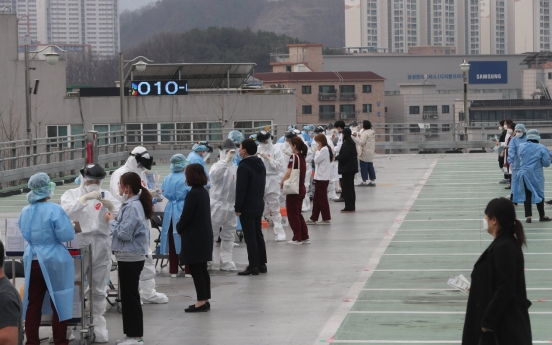 S. Korea's virus tally tops 10,000, 74 days after first case reported