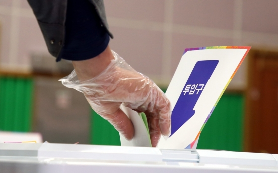 S. Koreans vote amid coronavirus outbreak with higher turnout than before