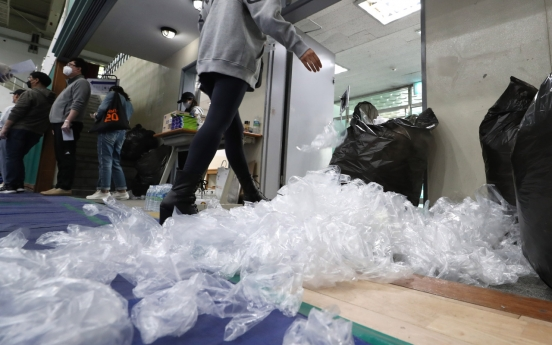 [Newsmaker] Single-use plastic gloves at polls raise eyebrows