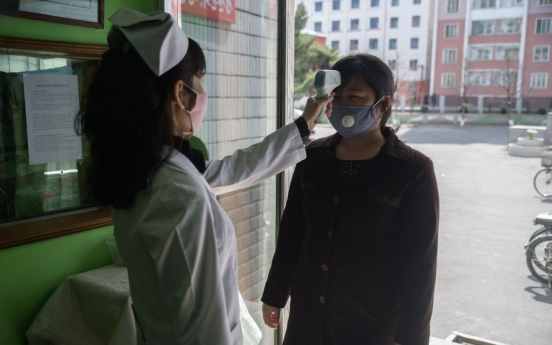 NK paper urges high-level alertness, tight border control against pandemic