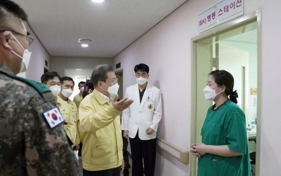 10 workers at military hospital test negative for virus