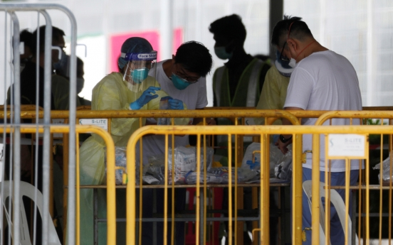 Singapore extends coronavirus curbs as cases surge