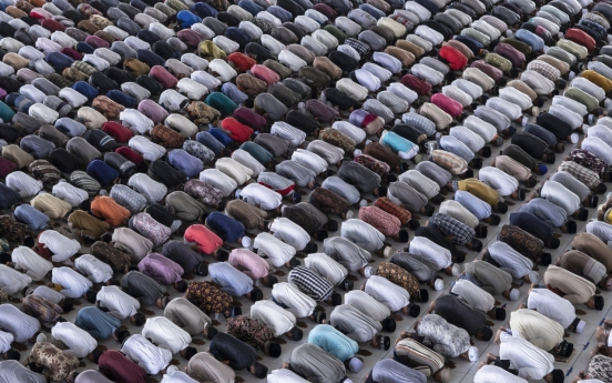 Muslims begin marking a subdued Ramadan under virus closures