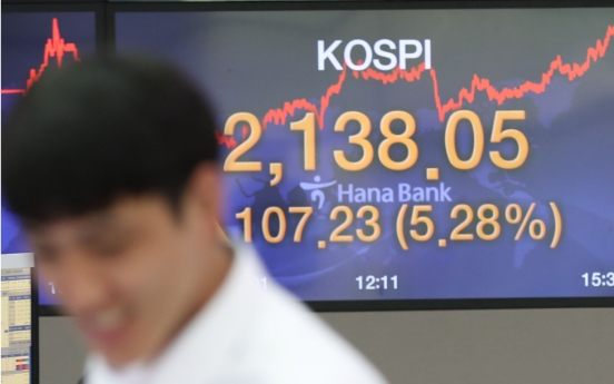 Seoul stocks spike over 5% on Fed's asset purchase scheme