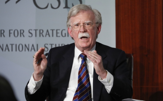 Bolton says Trump could meet Kim to win reelection