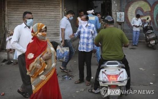 India passes 1 million virus cases as global crisis worsens