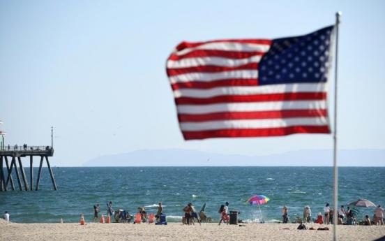 Masks spark political, legal battles in US as virus cases soar