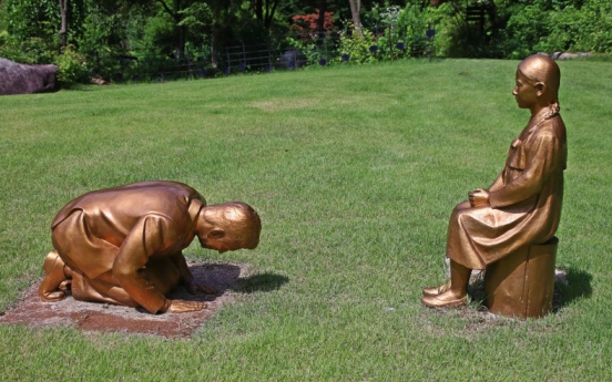 Kneeling man's statue stirs controversy in Seoul, Tokyo