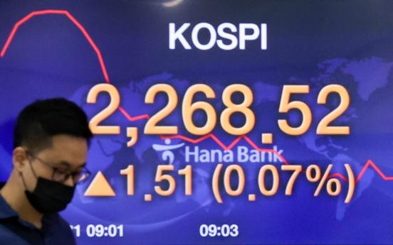Seoul stocks open tad lower on economic slump woes