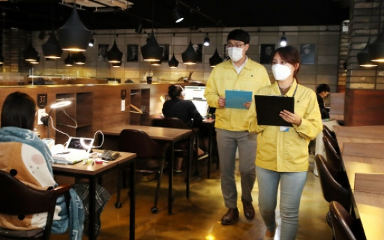 New virus cluster found at franchise coffee shop in Seoul