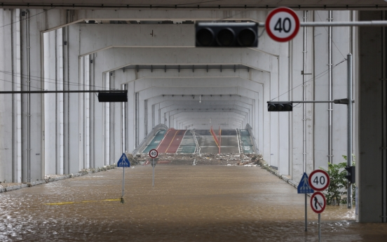 Damage from heavy rain continues to grow in S. Korea, leaving 13 dead, 13 missing
