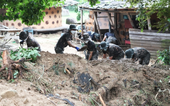 Death toll from heavy downpour rises to 14