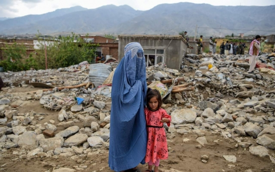 Search for bodies as Afghan floods kill more than 160