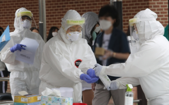 New virus cases under 200 for 12th day; eased virus curbs applied in greater Seoul