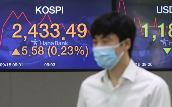 Seoul stocks open tad higher on brisk M&As, vaccine hopes