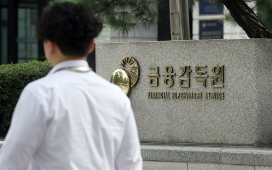 Financial holding firms' H1 net down 11% on increased provisions