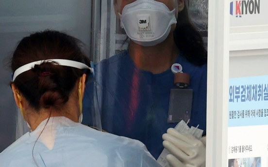 Coronavirus infections break out at Seoul face mask company