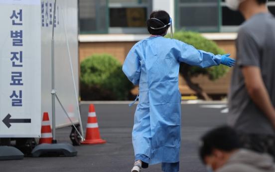 New virus cases under 200 for 2 weeks; marked slowdown still not in sight