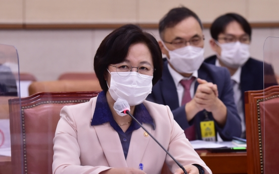 Prosecutors drop charges against justice minister in special favors probe