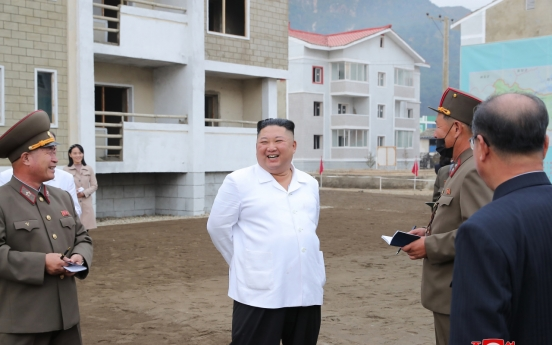 NK leader inspects flood recovery efforts together with sister